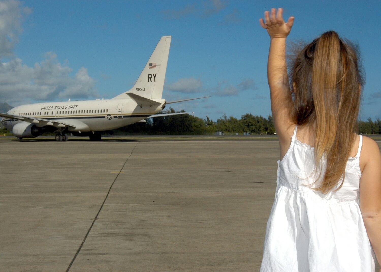 child-waving-goodbye